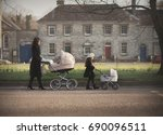 mother and little girl walking... | Shutterstock . vector #690096511
