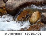 detail of river rocks with... | Shutterstock . vector #690101401
