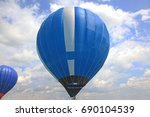 blue air balloon is floating in ... | Shutterstock . vector #690104539