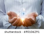 atom in the hands . the concept ... | Shutterstock . vector #690106291