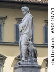 Small photo of FLORENCE, ITALY - JULY 25, 2017: statue of Dante Alighieri in the square of the Basilica of Santa Croce - Tuscany
