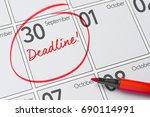 deadline written on a calendar  ... | Shutterstock . vector #690114991