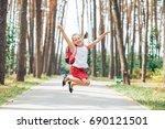 happy schoolgirl is jumping for ... | Shutterstock . vector #690121501