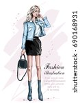 beautiful fashion girl with bag.... | Shutterstock .eps vector #690168931