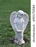 Statue Of A Child Angel In A...