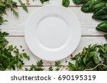 empty white plate in seasoning... | Shutterstock . vector #690195319
