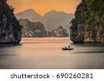 halong bay boats sunset at ha... | Shutterstock . vector #690260281