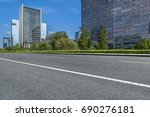 empty road and modern office... | Shutterstock . vector #690276181