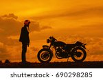 silhouette of biker man with... | Shutterstock . vector #690298285