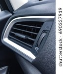 Small photo of Air Conditioner in car and switch on/off compartment.