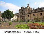 Small photo of Side aspect of Metropolitan Cathedral (Catedral Metropolitana) in Mexico City Zocalo Square, showing a native Mexican garden of cactus, shrubs, grasses, and flowers
