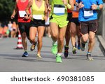 woman and many men running t... | Shutterstock . vector #690381085