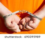 hands in handcuffs. arrest. law ... | Shutterstock . vector #690395989