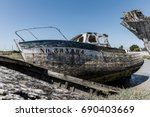 wreck at the boat cemetery at... | Shutterstock . vector #690403669