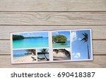 photobook album on deck table... | Shutterstock . vector #690418387