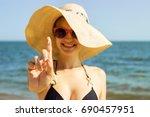 suntan lotion woman applying... | Shutterstock . vector #690457951