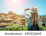 woman tourist with her phone... | Shutterstock . vector #690523645