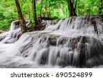 huay mae kamin waterfall in... | Shutterstock . vector #690524899
