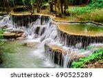 huay mae kamin waterfall in... | Shutterstock . vector #690525289