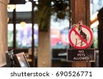 NO PET ALLOW sign at the restaurant in warm tone
