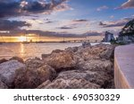 sunset at ocean with sailboats | Shutterstock . vector #690530329