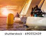 sailboat at sunset. sailing... | Shutterstock . vector #690552439