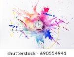 pocket watch on a spilled paint ... | Shutterstock . vector #690554941