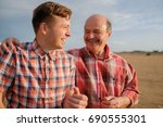 portrait of happy father and... | Shutterstock . vector #690555301