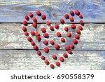 heart from raspberry. heart... | Shutterstock . vector #690558379