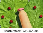 smoothies with raspberries in a ... | Shutterstock . vector #690564301