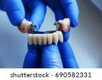 dental bridge | Shutterstock . vector #690582331