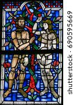 Small photo of WORMS, GERMANY - JULY 4, 2017: Stained Glass in Wormser Dom in Worms, Germany, depicting Adam and Eve