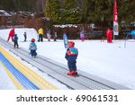CHAMONIX-MONT-BLANC - JANUARY 07: Ski instructors study young skiers in children ski school, January 07, 2011 in Chamonix-Mont-Blanc, France - stock photo
