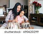 beautiful indian woman wearing... | Shutterstock . vector #690620299