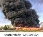warehouse engulfed in raging... | Shutterstock . vector #690621964