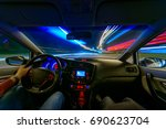 movement of the car at night at ... | Shutterstock . vector #690623704