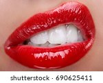 closeup of lips with red glance ... | Shutterstock . vector #690625411