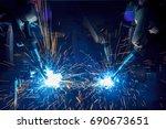 welding robots movement in a... | Shutterstock . vector #690673651