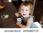 cute little boy eating yogurt. | Shutterstock . vector #690680719