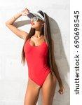 sexy girl in swimsuit in studio ... | Shutterstock . vector #690698545