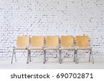 Row Of Five Empty Modern Chair...
