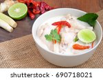 Stock photo tom kha gai on wooden table in thailand restaurant chicken coconut soup 690718021
