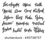set of handwritten city names.... | Shutterstock .eps vector #690738757