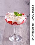 Small photo of Strawberry trifle in a glass on table