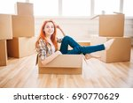 woman sitting in carton box ... | Shutterstock . vector #690770629