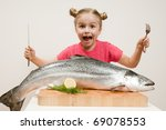 Little Girl And Big Fresh Fish...