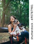 Stock photo dog walker with dogs enjoying in park 690787981