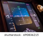 Small photo of Close up Primary flight information display in modern commercial aircraft during cruise at altitude 35000 feet with auto pilot engagement