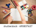 cute child paints with colored... | Shutterstock . vector #690837637