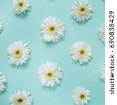 pattern of white chamomile... | Shutterstock . vector #690838429